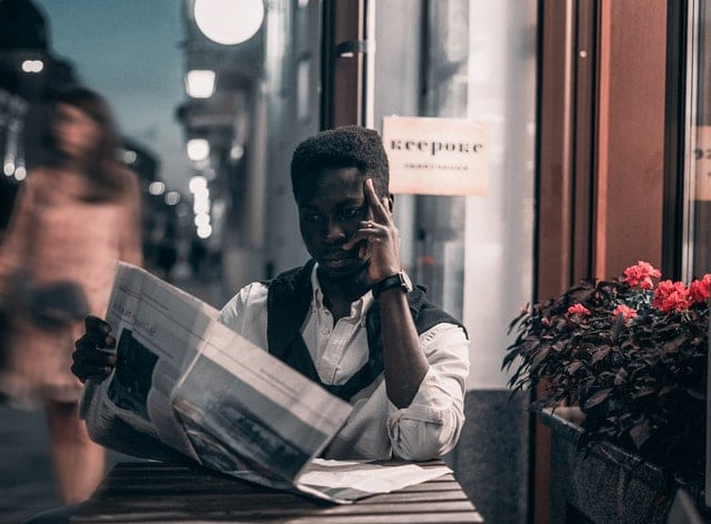 business person reading newspaper